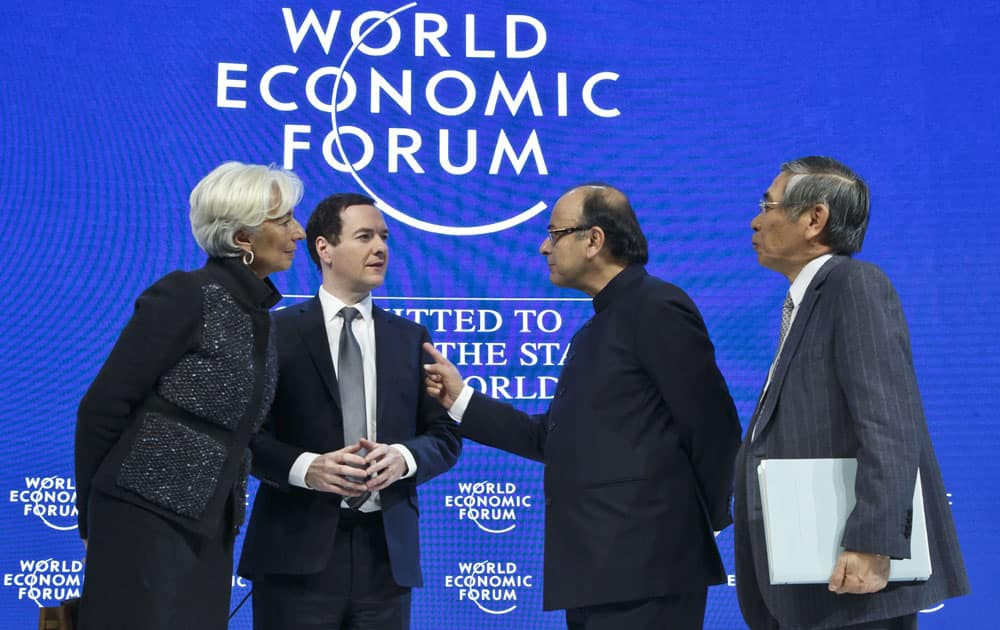 Managing Director of the International Monetary Fund, Christine Lagarde, left, Britain's Chancellor of the Exchequer George Osborne, 2nd left, Indian's Finance Minister Arun Jaitley, 2nd right, and Governor of the Bank of Japan. Haruhiko Kuroda, talk after a panel