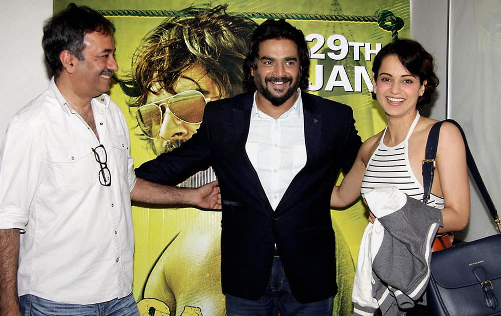 Bollywood actors R Madhavan, Kangana Ranaut with filmmaker Rajkumar Hirani during the screening of film Saala Khadoos, in Mumbai.
