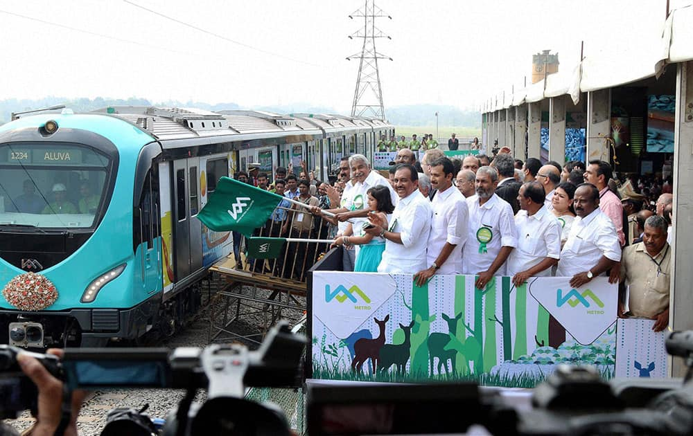 Kerala Chief Minister Oommen Chandy flags of the first test run of Kochi Metro Rail project in Kochi.
