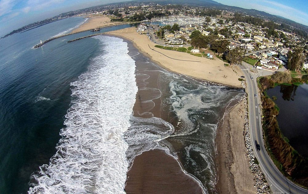 This photo provided by The Nature Conservancy shows Twin Lakes Beach in Santa Cruz, Calif. and Schwann Lagoon, the body of water on the right.