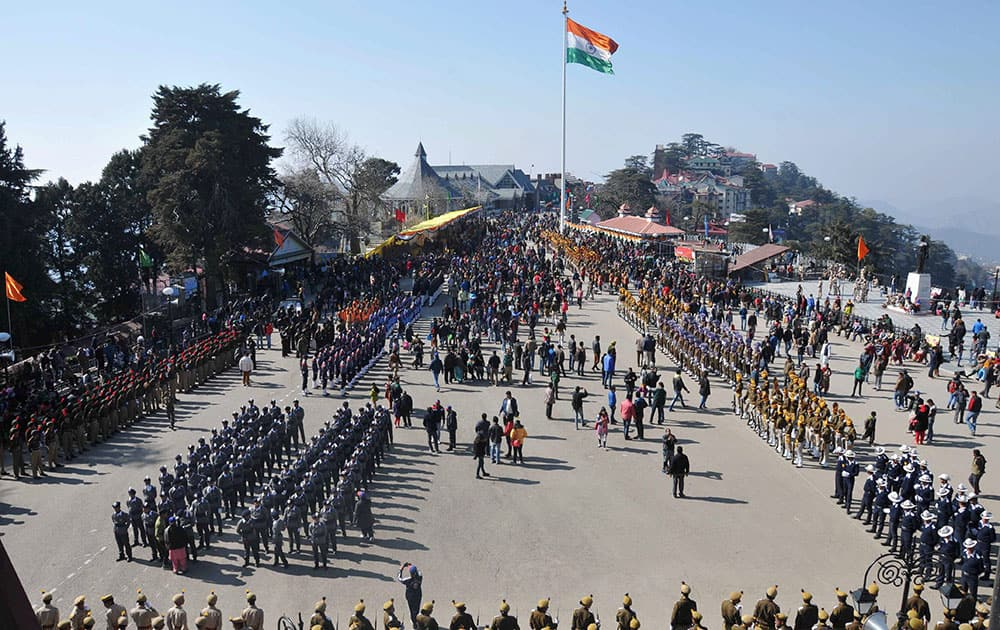 Indian army soldiers march during the full dress rehearsal for the Republic Day parade in Shimla.