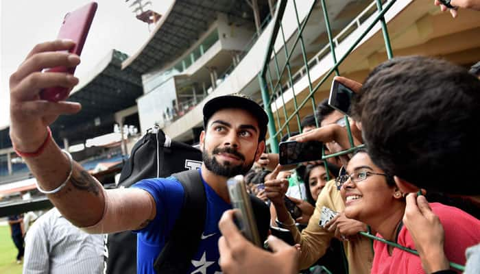 Ladies' man! Virat Kohli bowls over members of India's women's cricket team