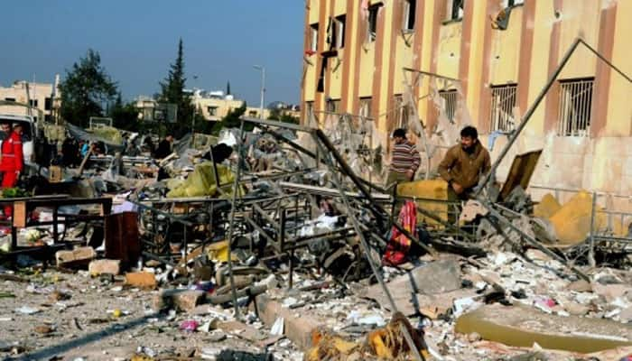 '17 dead in blasts at Army checkpoint in Syria`s Homs'