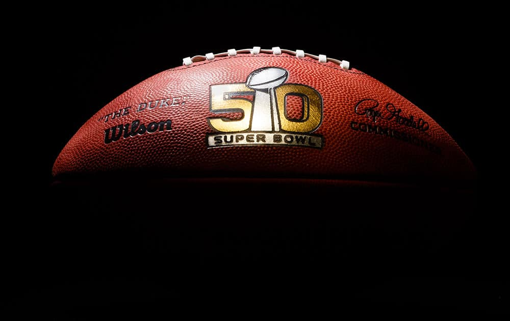 An official game ball for the NFL Super Bowl 50 football game is photographed.