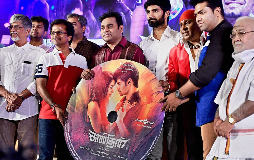 Music composer A. R. Rahman with actors Atharvaa, A.R. Murugadoss, Sivamani and others during the audio launch of their upcoming movie Kanithan in Chennai.