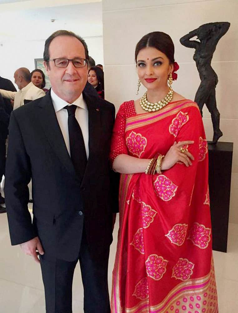French President Francois Hollande with actress Aishwarya Rai Bachchan at a special luncheon in New Delhi.