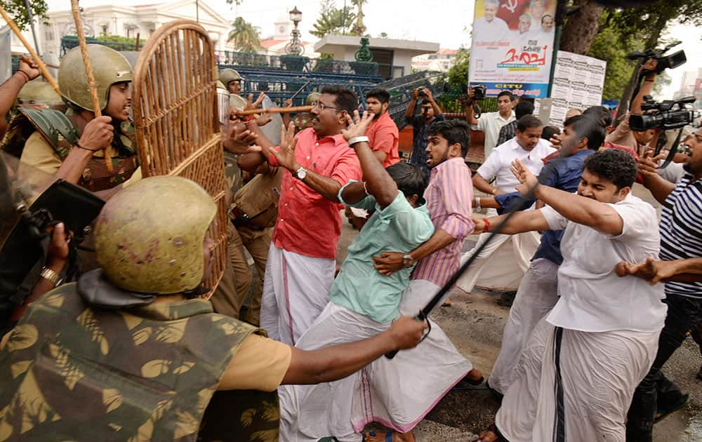 Police cane charge Bharatiya Janata Yuva Morcha members during a protest in Thiruvananthapuram.