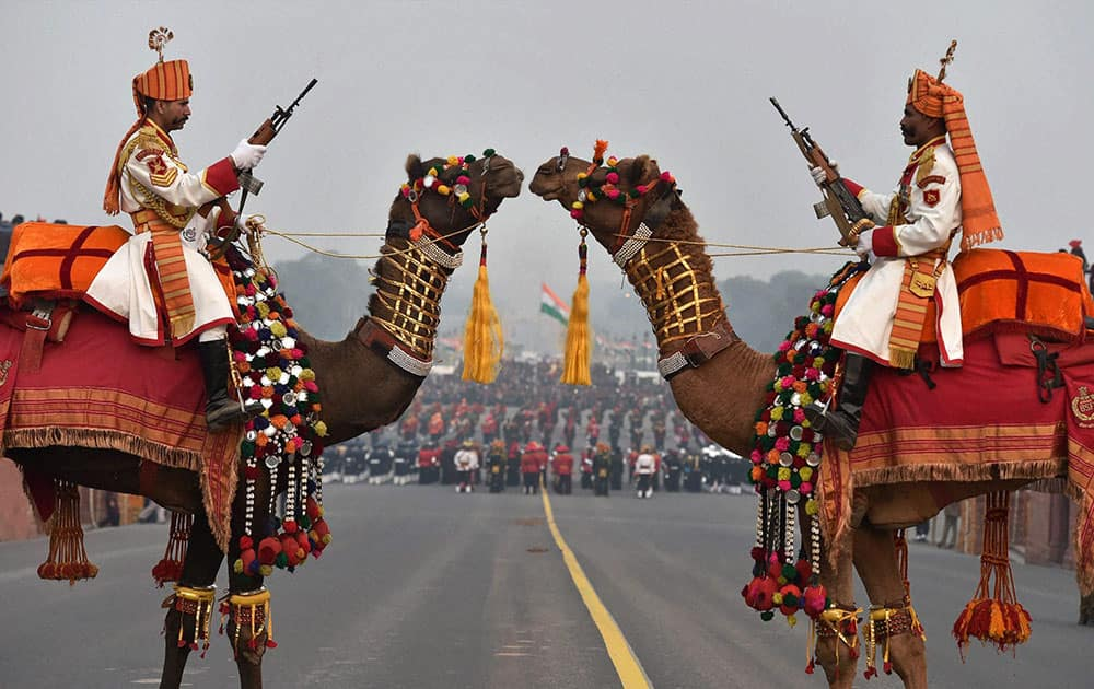 BSF soldiers mounted on camels participate in rehearsal for the Beating Retreat ceremony in New Delhi.