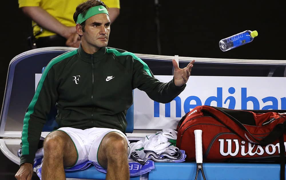 Roger Federer of Switzerland throws his empty water bottle during a break in his semifinal match against Novak Djokovic of Serbia at the Australian Open tennis championships in Melbourne, Australia.