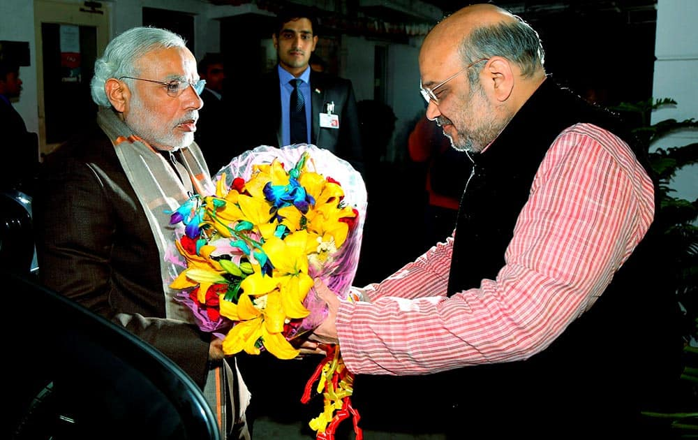 Prime Minister Narendra Modi is received by BJP President Amit Shah as he arrives to attend the partys parliamentary board meeting in New Delhi.