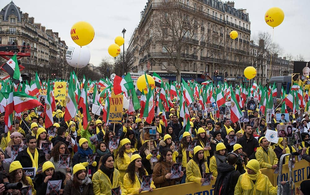Iranian opposition protesters take the streets in Paris to protest against executions in Iran, as Iranian President Hassan Rouhani is in France for a two-day official visit.