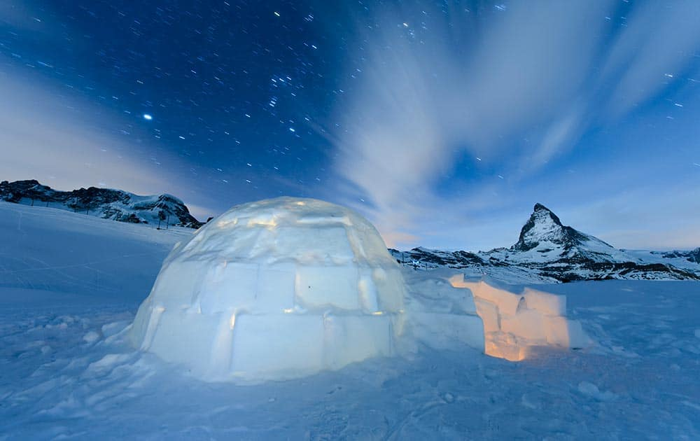 Long-time exposure photo shows an Igloo at the 'Igloo village' (Iglu Dorf) in front of the famous Matterhorn mountain in Zermatt, Switzerland.