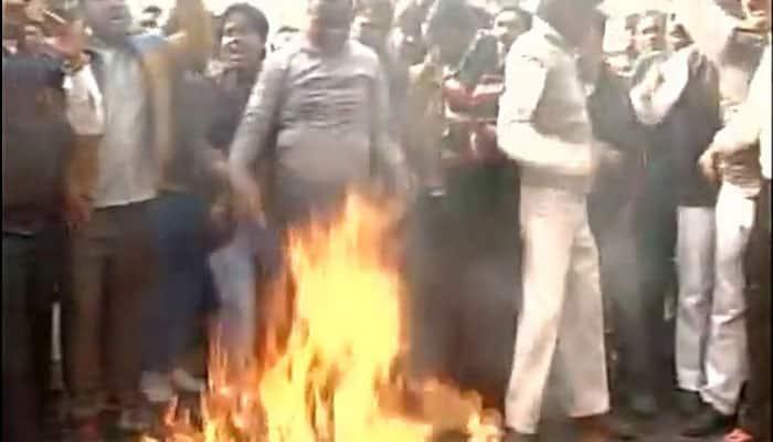 MCD workers protest outside Delhi Assembly Speaker Ram Niwas Goel's residence