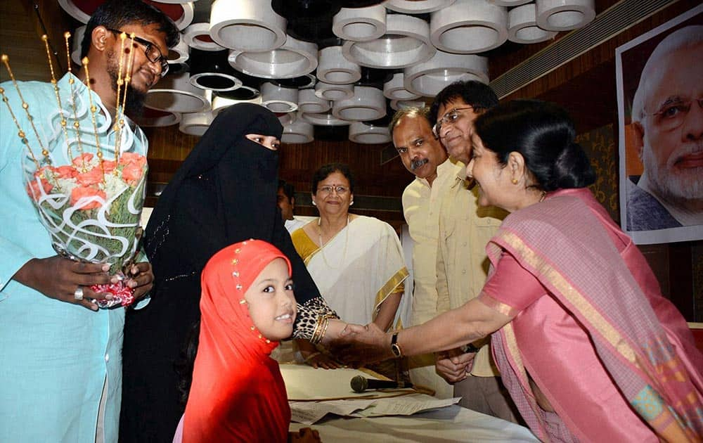 Union Minister Sushma Swaraj interacts with a local Muslim family during her visit to Mumbai on Friday as part of Prime Minister Narendra Modis directive to his ministers to reach out to the people on the work done by the NDA government.
