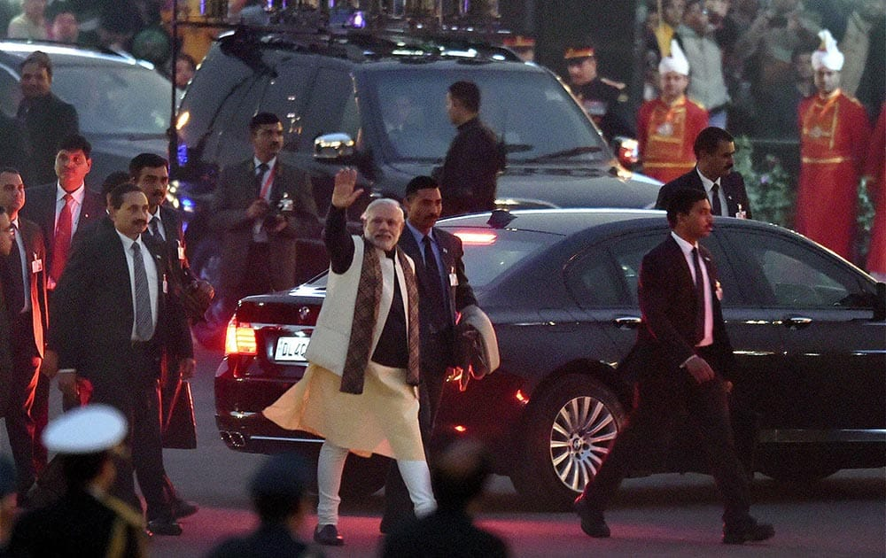 Prime Minister Narendra Modi waves as he leaves after attending the Beating Retreat ceremony at Vijay Chowk in New Delhi.