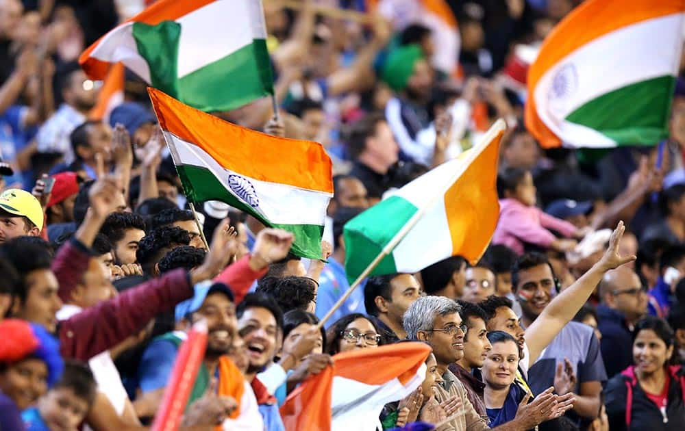 Indian fans wave flags during their T20 cricket match against Australia in Melbourne, Australia.