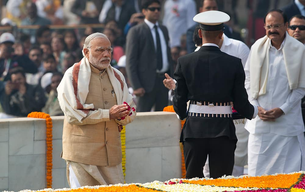 Prime Minister Narendra Modi pays tributes at Rajghat, a memorial to Mahatma Gandhi, on his death anniversary in New Delhi.