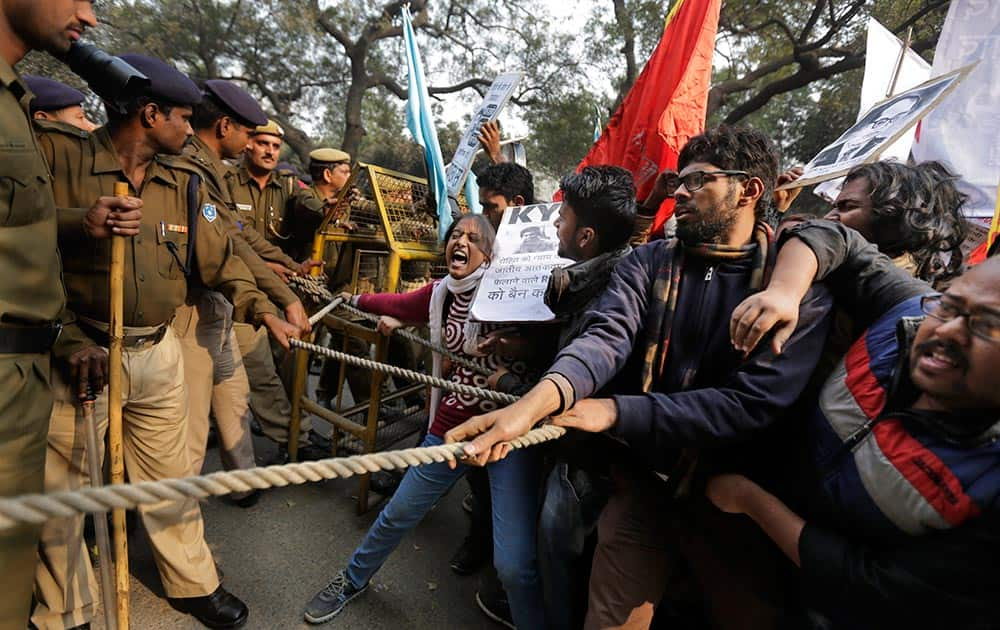 Students try to make their way through police barricade as they march towards the office of Hindu nationalist Rashtriya Swayamsevak Sangh (RSS) or the National Volunteers Association's office during a protest against the death of 26-year-old doctoral student Rohith Vemula in New Delhi.