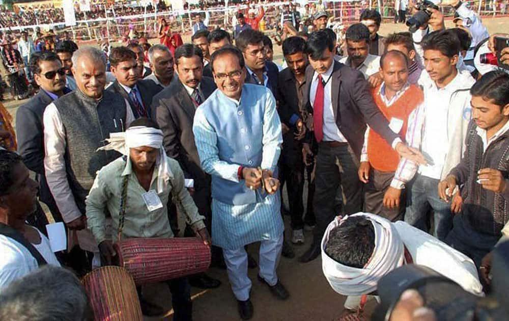 Madhya Pradesh Chief Minister Shivraj Singh Chouhan dancing with Tribals during a programme in Sidhi district of Madhya Pradesh.