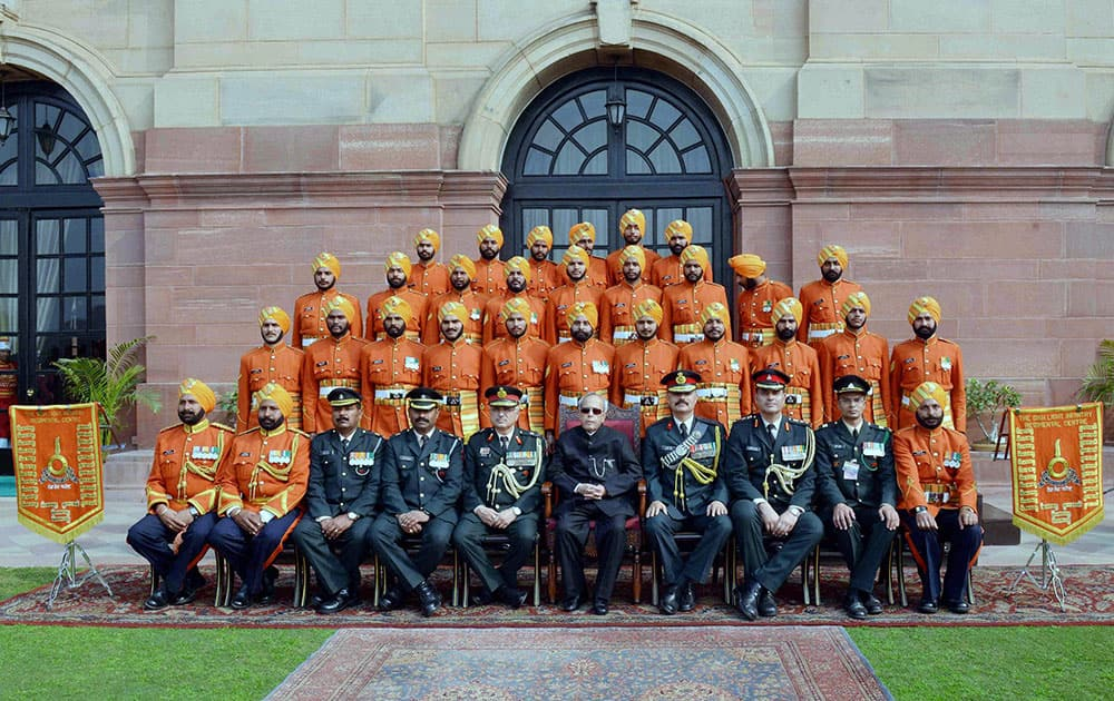President Pranab Mukherjee meeting with the personnel of Tri Service Band Contingents (participants of the Beating Retreat Ceremony) & Provost Outriders of the Three Services at Rashtrapati Bhavan in New Delhi.