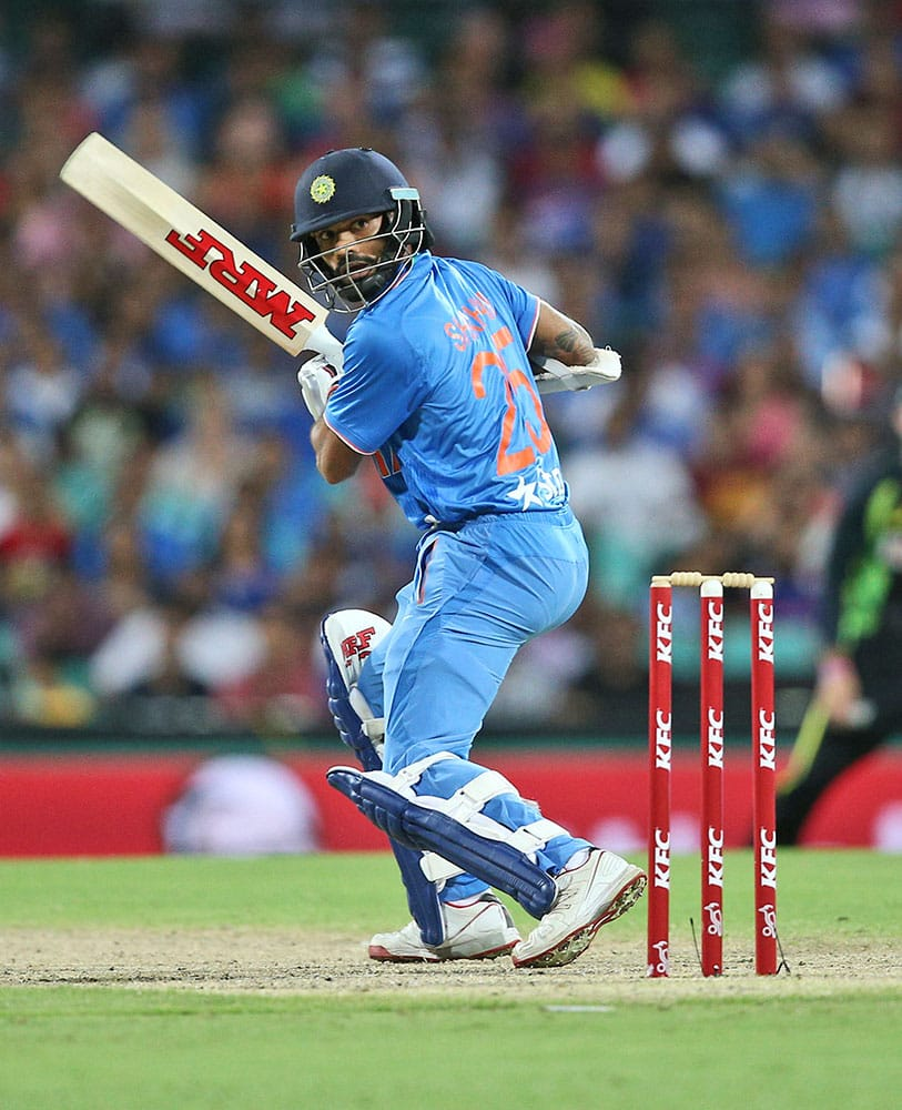Indian batsmen Shikhar Dhawan looks back as he is caught out by Australia's wicket keeper Cameron Bancroft during their T20 International cricket match in Sydney, Australia.