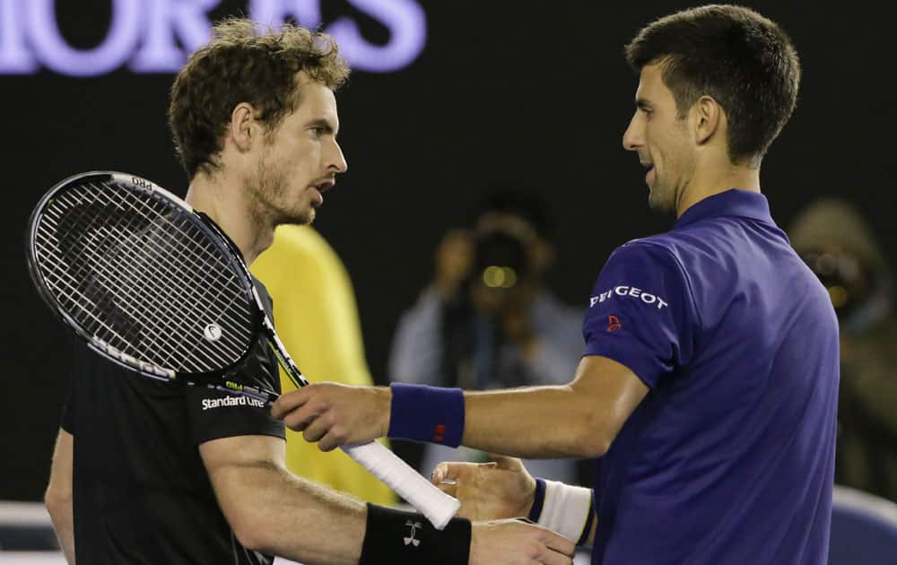 Novak Djokovic, right, of Serbia is congratulated by Andy Murray of Britain after winning the men's singles final at the Australian Open tennis championships in Melbourne.