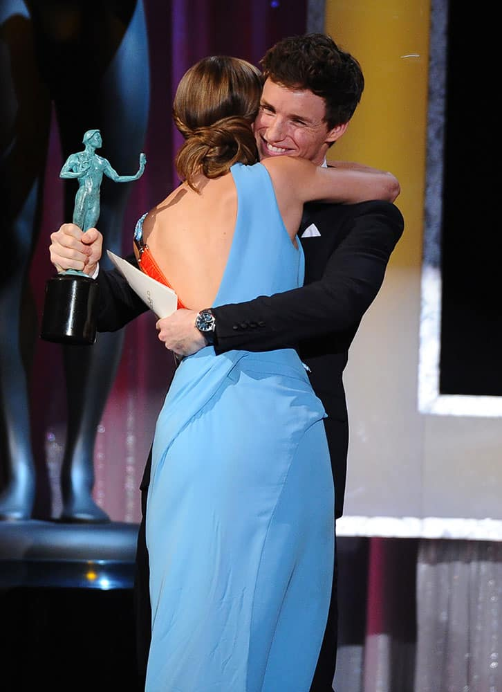 """Eddie Redmayne, right, presents Brie Larson with the award for outstanding female actor in a leading role for """"Room"""" at the 22nd annual Screen Actors Guild Awards at the Shrine Auditorium & Expo Hall."""