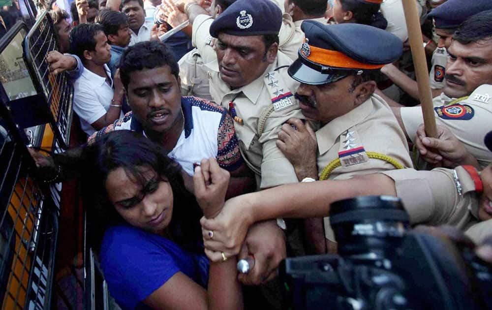Police detain students protesting over Rohith Vemulas suicide outside CST in Mumbai.