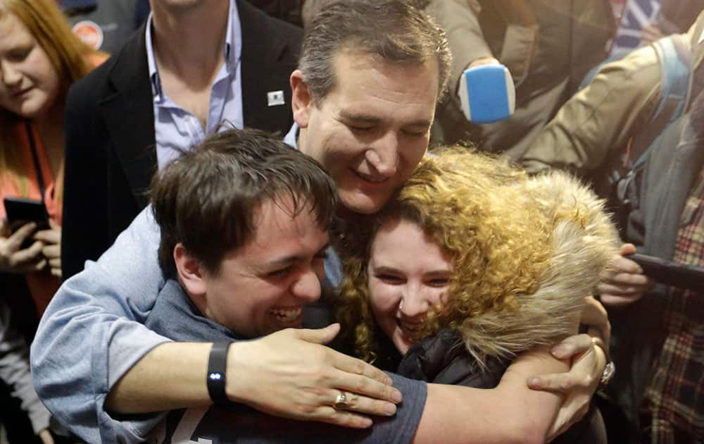 Republican presidential candidate, Sen. Ted Cruz, R-Texas, hugs Arden Jurskis and Kenzy Peach after Arden proposed Kenzy in front of Cruz at a campaign event at Iowa State Fairgrounds.