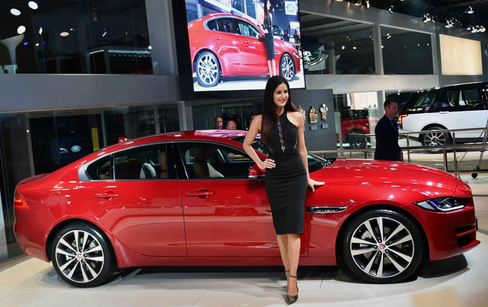 Actress Katrina Kaif poses with a Jaguar Land Rover at Auto Expo 2016 in Greater Noida on Wednesday. Jaguar launched the XE in India at the expo