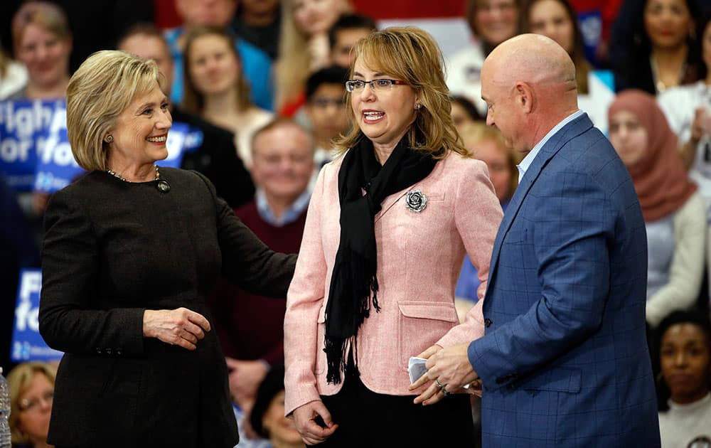 Democratic presidential candidate Hillary Clinton is joined by former Rep. Gabrielle Giffords, and her husband astronaut Mark Kelly during a campaign stop in Manchester, N.H.