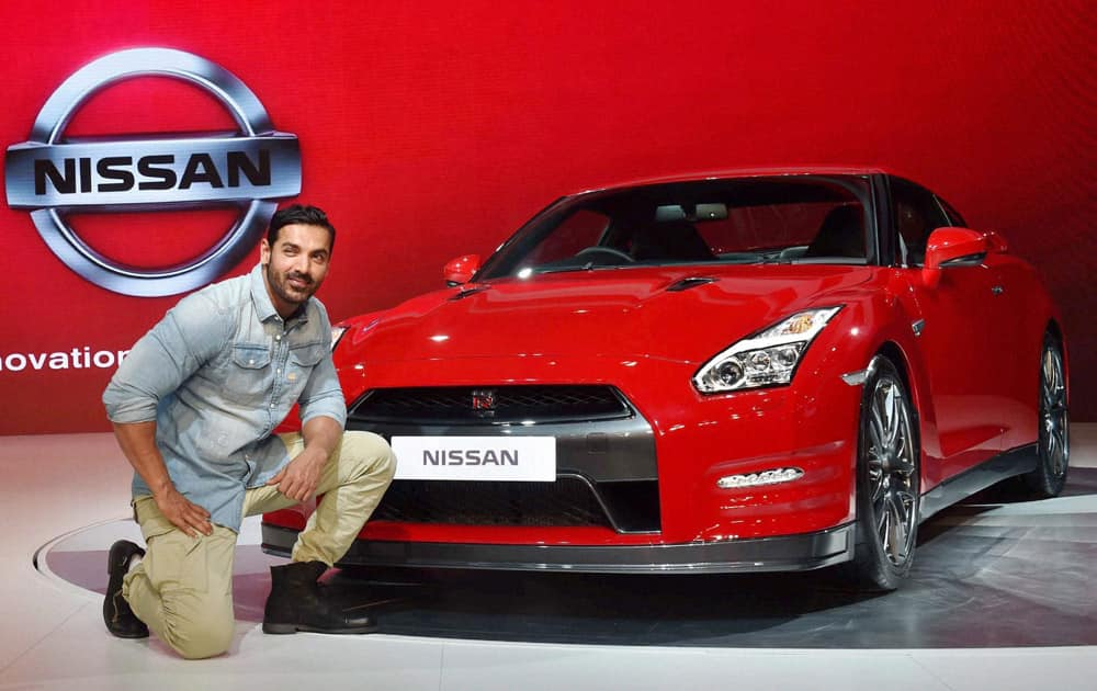 Newly-appointed brand ambassador of Nissan India, actor John Abraham at the companys gallery at Auto Expo 2016 in Greater Noida on Thursday.