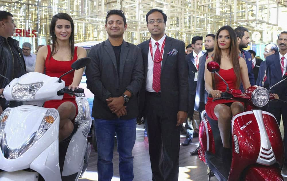 Cricketer Piyush Chawla and CEO, Lohia Auto Industries, Ayush Lohia at the unveiling of the companys path-breaking range of electric vehicles at Auto Expo 2016 in Greater Noida on Thursday.