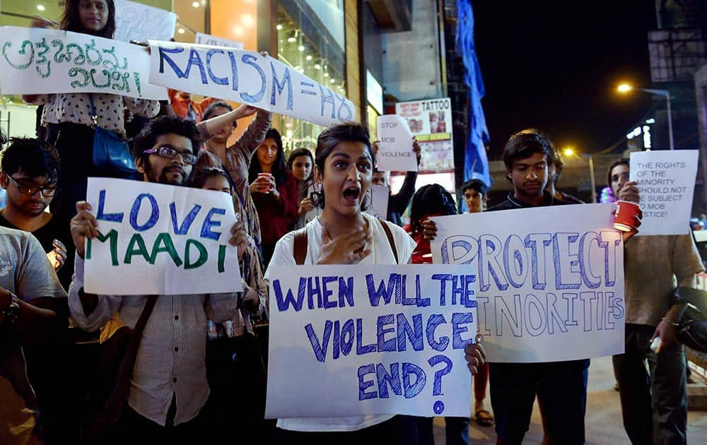 Students from different colleges hold placards and Candles during a protest against the attack on a Tanzanian Girl by a mob in Bengaluru.