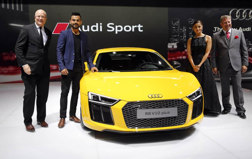 Indian cricketer Virat Kohli, second left and Bollywood actor Alia Bhatt during the launch of Audi R8 V10 plus at the Auto Expo in Greater Noida, near New Delhi.