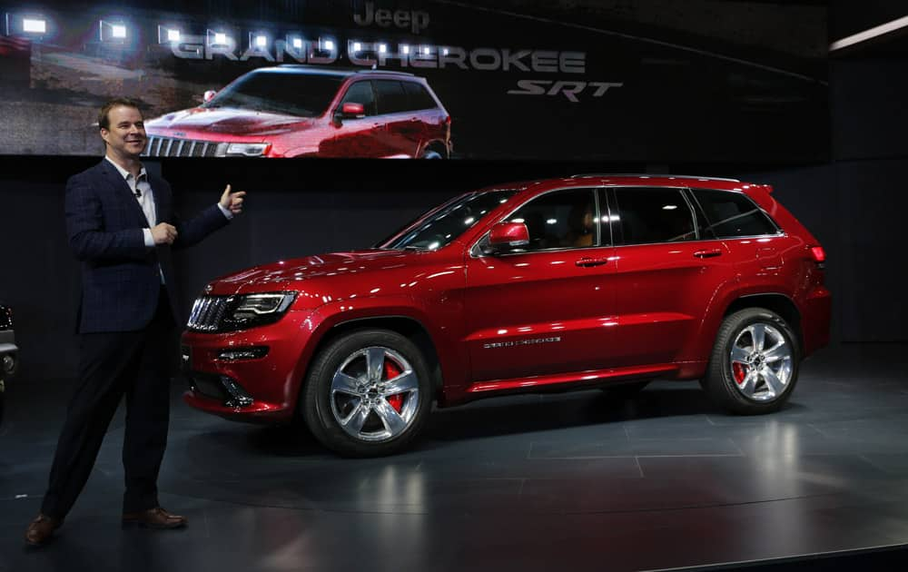 Jim Morrison, Director of Jeep Brand Product Marketing unveils the Grand Cherokee SRT at the Auto Expo in Greater Noida, near New Delhi.