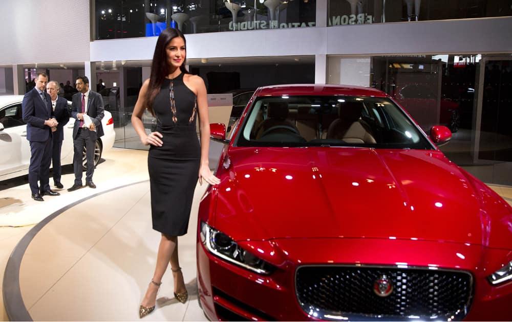 Bollywood actress Katrina Kaif poses next to the newly launched