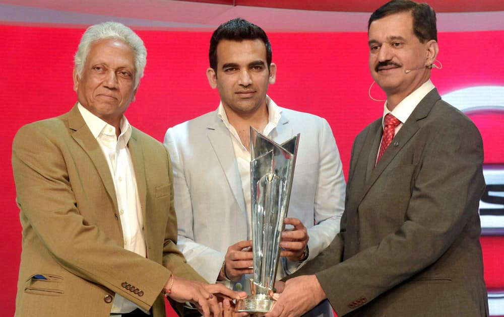 Former cricketers Mohinder Amarnath and Zaheer Khan unveil the World T20 Trophy at Nissan stall during the Auto Expo 2016 at Greater Noida.