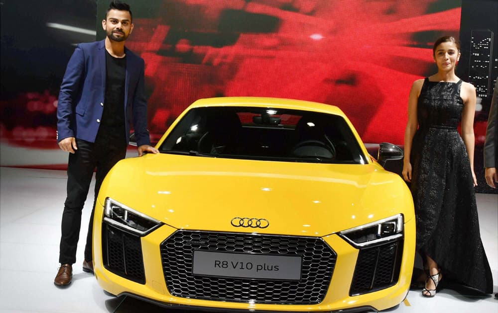 Cricketer Virat Kohli and actress Alia Bhatt at the launch of Audis new sports car R8 V10 plus at Auto Expo 2016 in Greater Noida.