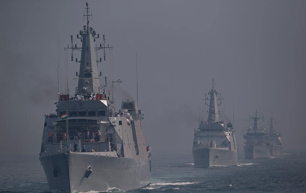 Indian naval ships are seen during the final rehearsal of the International Fleet review in Vishakapatnam.