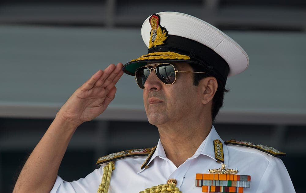 Indian Chief of Naval Staff Robin K. Dhowan salutes sailors during the final rehearsal of the International Fleet review in Vishakapatnam.