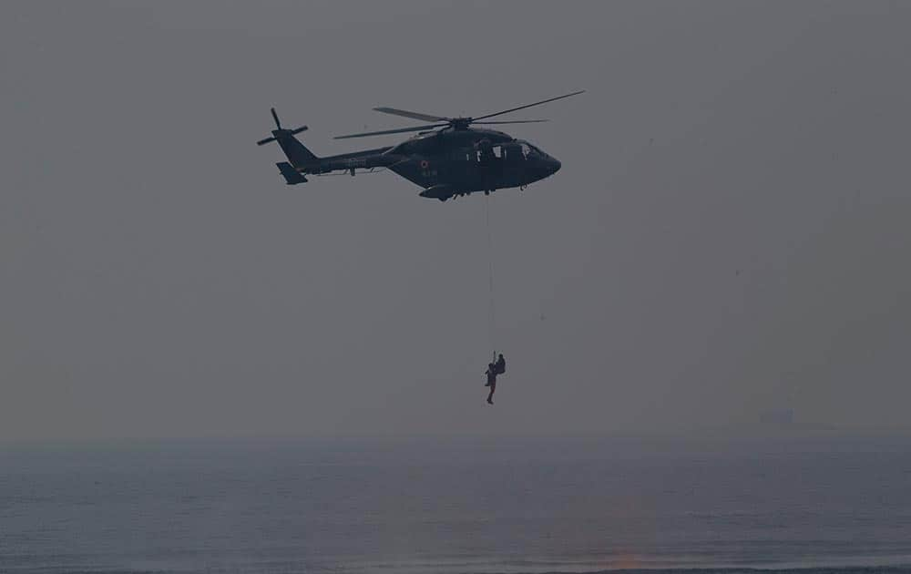 An Indian navy helicopter shows a rescue operation during the final rehearsal of International Fleet review in Vishakapatnam.