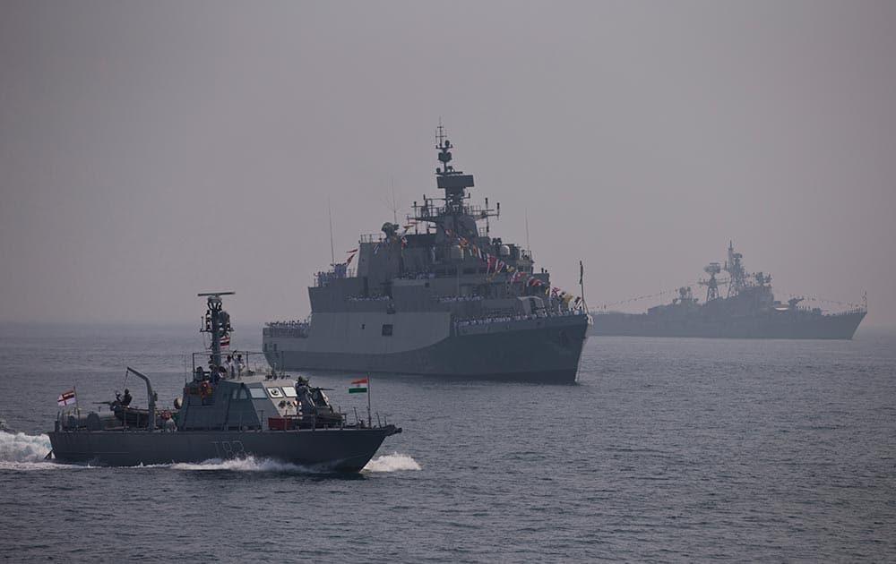 Warships are seen during the final rehearsal of International Fleet review in Vishakapatnam.