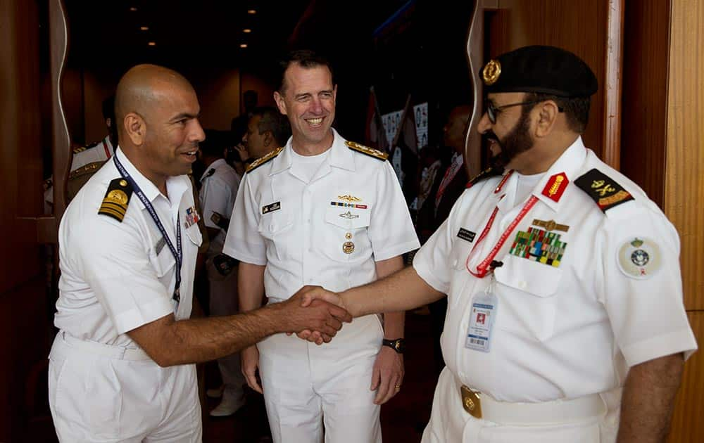 U.S. Chief of Naval Operations John Richardson, center, meets other foreign delegates during the International Fleet Review in Vishakapatnam.