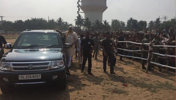 WATCH: When PM Modi took his supporters by surprise, came to meet them standing on car's side foot step