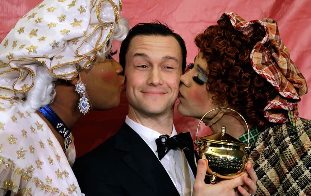 Actor Joseph Gordon-Levitt is kissed by two actors in drag after being awarded the pudding pot as Harvard University's Hasty Pudding Theatricals Man of the Year in Cambridge, Mass.