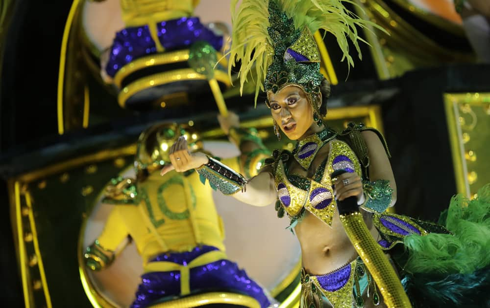 A performer from Grande Rio samba school parades on a float during the Carnival celebrations at the Sambadrome in Rio de Janeiro, Brazil.