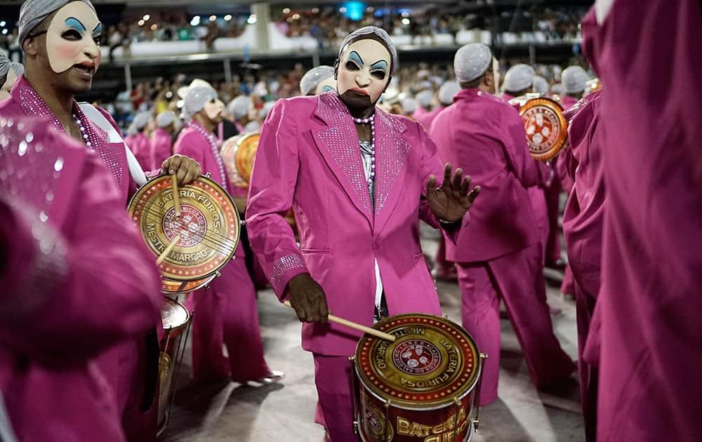 Members of the Salgueiro samba school perform during a Carnival parade inside the Sambadrome of Rio de Janeiro, Brazil.