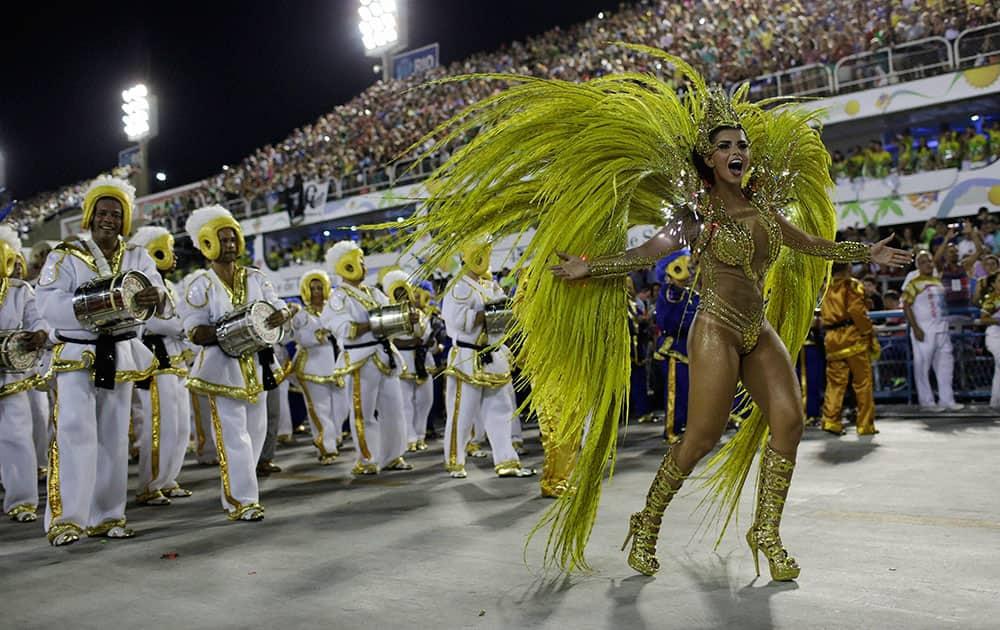 Drum queen Bianca Leao, from Uniao da Ilha samba school, dances during the Carnival parade at the Sambadrome.