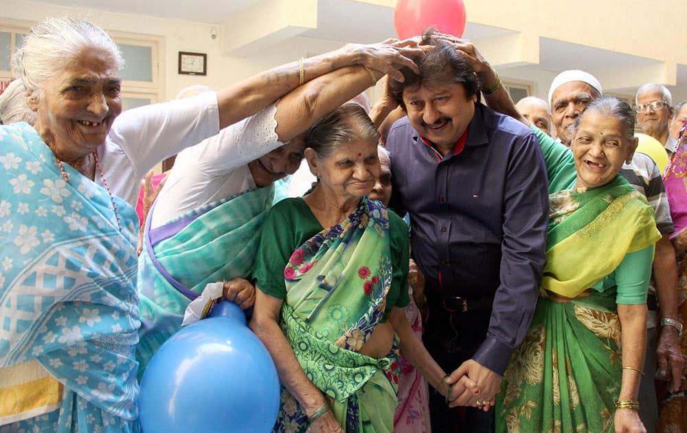 Ghazal maestro Pankaj Udhas being blessed by Senior citizens at Sir J. J. Dharmashala, in Mumbai.